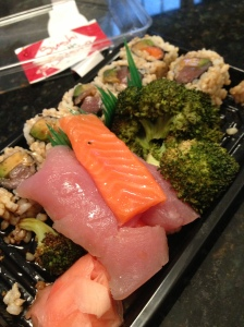 tuna and salmon sushi, both sashimi and rolls w/ avocado plus broccoli