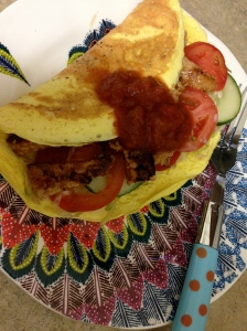 epic omelette with fake chicken tomato cucumbers and salsa