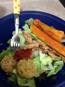 salad with sweet potato wedges, quinoa bites & salsa, and fake chicken