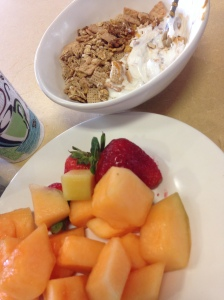 some fruit and greek yogurt with cereal and peanut butter mixed in