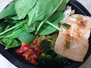 spinach, rice and quinoa mix with veggies and salmon