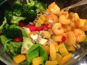 big salad on butter lettuce, yellow peppers, avocado, broccoli, tomatoes and shrimp