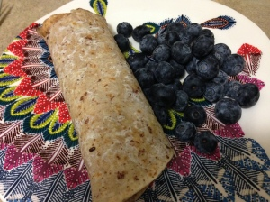 whole wheat wrap with eggs inside and blueberries
