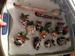 chocolate covered strawberries and pretzels plus more trays of prezels