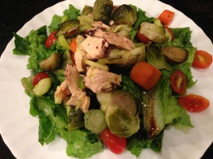 salad with tomatoes, salmon, and brussel sprouts