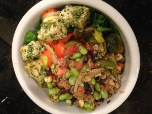 salad with quinoa mix, veggies, and pesto tofu