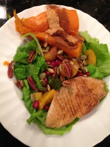 salad with sweet potato, nuts, tangerine, and tilapia