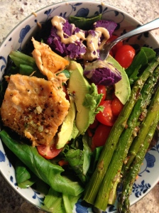 salad with garlic asparagus, salmon, avocado, tomatoes, and purple potato