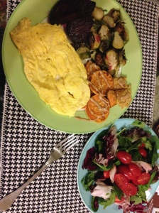 eggs with beets, brussels sprouts, salad with tomatoes and sweet potato with cashew butter