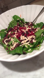 big salad I made with mixed greens, craisins, slivered almonds, pomegranate seeds, and a pomegranate vinaigrette