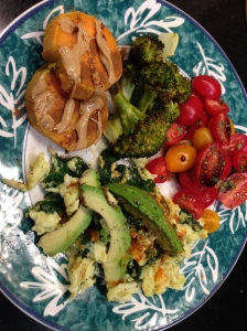 sweet potato with cashew butter, spinach and eggs with avocado, enchilada sauce and tomatoes and broccoli