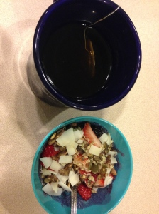 berry bowl with green power, coconut flour, granola and coconut plus tea