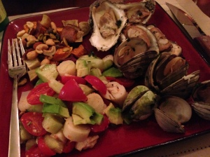 feast! plate one- tomato/cucumber/hearts of plan/avocado salad, sweet potatoes, clams and oysters