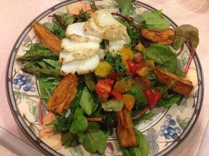 salad with baked cod, sweet potato wedges, tomato with orange/lemon sauce, and asparagus