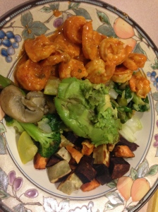 salad with shrimp and thai sauce, sweet potatoes, veggies, and avocado