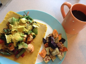 turmeric wrap with eggs, beet hummus, veggies, avocado and nutritional yeast plus sweet potatoes with coconut butter and coffee