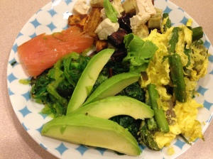 eggs with veggies, sautéed kale, avocado, smoked salmon, and sweet potatoes