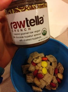 quaker oatmeal squares with rawtella and some trail mix with m&m's