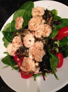 salad with kale sprouts, peppers, and coconut shrimp